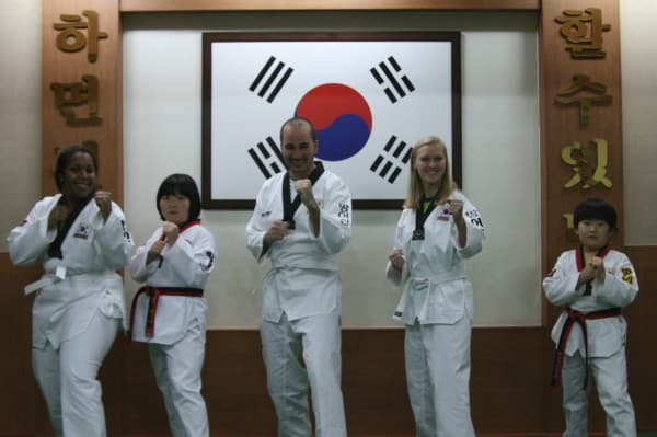 Alexis, Griffin and Valerie with the small korean black belts that could at any moment turn on us and kill us with just their pinky finger!